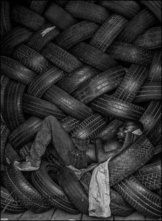 Ghana.  I am glad those are tires and not what I first thought. ~Sandra Bell Kirchman