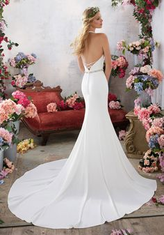 Morilee by Madeline Gardner 'Melanie' 6855 | Simple and Understated, This Stunning Crepe Sheath Features a Flattering Halter Neckline and Jewel Beaded Belt for an Added Touch of Sparkle. Open Back Accented with Beaded Criss-Cross Strap Detail. Removable Beaded Crepe Belt Included (Beaded Crepe Belt Also Sold Separately as Style #11257). Colors Available: White/Silver, Ivory/Silver. Shown in Ivory/Silver.