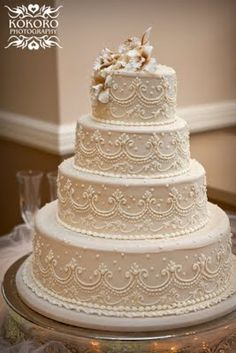 Buttercream ivory wedding cake with scroll detail