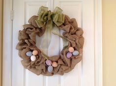 18 inch burlap wreath with easy to remove Easter bow and decor.  Available for purchase on Etsy at SCDoorDecor.