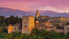 Granada moorish castle in the sunset with Sierra Nevada mountains in the background #trivo