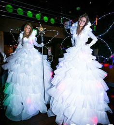 Gorgeous fairy stilt walkers with LED wings.