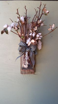 County wall sconce with mason jar, bow, and dried cotton stems