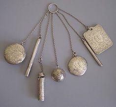 A silver set of a mirror, pillbox, dance cards, coin ball, lipstick case, pencil, etc.