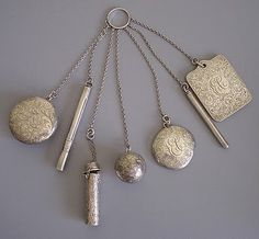 A silver set of a mirror, pillbox, dance cards, coin ball, lipstick case, pencil, etc.