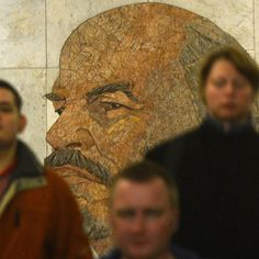 Passengers walk past a portrait of Vladimir Lenin, one of the founders of the Soviet Union, in the Biblioteka Imeni Lenina metro station in Moscow. Lenin died on January 21st 1924 at Gorki Leninskiye, his datcha located just south of the capital. The metro station is one of the original 13 opened in Moscow in May 1935. Photo taken on November 14th 2012. Credit: AFP/Kirill Kudryavtsev #publicart #Moscow #art #mosaic #Lenin #Russia #metro