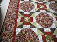 This would be a pretty Christmas quilt.  Handmade Throw Size Quilt bed topper couch cover in a by djwquilts, $200.00