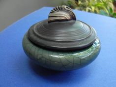 "ANDREW MACCORKINDALE - LIDDED JAR - HIGH FIRED PORCELAIN - CRACKLE GLAZE & METALLIC BLACK - 3 3/4"" X 2 3/4"" (with lid) -  A very finely thrown porcelain jar made by master potter: Andrew MacCorkindale in his Portland, OR, MacCorkindale Porcelain Studio. The lid is a flat gun metal black and features MacCorkindale's classic """"shell"" handle."