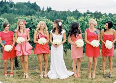 I like the idea of having all the bridesmaids in different dresses but of the same colorscheme. It really moves away from traditional wedding ideas while still having the bride stand out!