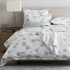 Caroline 400-Thread Count Sateen Bedding - Sprigged with long-stemmed blooms in restful shades of celadon, olive, and teal on cream, this modern floral bedding brings a sense of tranquility to the bed.