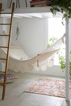 A hammock is the perfect place to recline and relax. Install an indoor hammock for beachy relaxation all year long. For more indoor hammock design ideas, visit domino. My New Room, My Room, Girl Room, Hammock In Bedroom, Cottage Shabby Chic, Hangout Room, Indoor Hammock, Teen Girl Bedrooms, Awesome Bedrooms