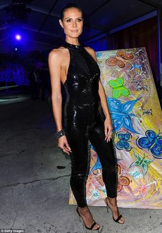 Wow factor: Heidi Klum poured herself into a skintight black bodysuit that left little to the imagination