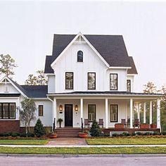 Exterior. Board and batten and ship lap siding, simple columns and no porch rail. Clean farmhouse design. White siding, black windows