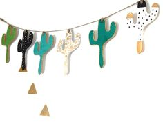 Cactus Bunting / Garland Hanging Wall Decoration Individually cut and hand painted clay cacti. A funky, fresh modern decoration ideal as a gift for someone you love, or a treat just for yourself! Great for filling wall spaces in any room especially a childs bedroom, nursery, playroom or any room with a desert, wilderness or wanderlust theme. This bunting also looks great on a feature walls for example in an office, work space or studio. These decorations are available individually in green…