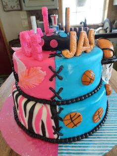 Children's Birthday Cakes - This was for a brother & sister birthday party.  Cakes are covered in BC & MMF.  Names on top are MMF/gumpaste mixture.  Large basketball is RKT covered in chocolate.  Hoop is gumpaste.  Feathers are wafer paper.  all other decorations are MMF.  Border is black sixlett candies.