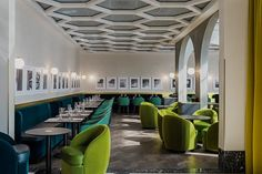 Honeycomb panel ceiling and chairs of chartreuse, teal, and turquoise are among the stunning decor details of I Love Paris // The New Hot Spot at Paris's Charles de Gaulle Airport