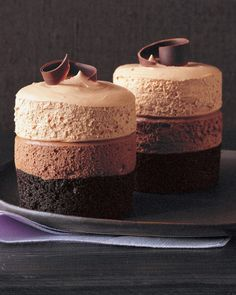 Triple-Chocolate Mousse Cake: A bottom layer of dark chocolate cake is topped with silky bittersweet and milk chocolate mousses. Use a vegetable peeler to form the decorative dark chocolate curls that garnish these spectacular little cakes.