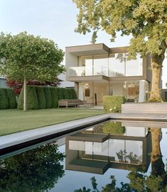 The G house, Ammersee by Bembé Dellinger Architekten. Restrained garden design. Pinned to Garden Design by Darin Bradbury.