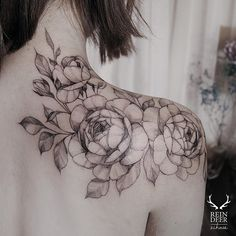 Sketchy black outline flowers tattoo