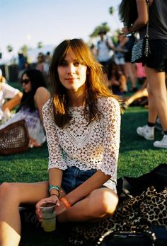 Sitting on the grass in a music festival.