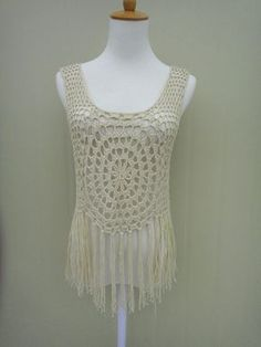Cute long fringe crochet vest Perfect to creat a hippie boho chic look or as beach cover up with your favorite crochet bikini set  Measurement: Bust: 35-38 Length: 17 and 24with tassels  Crocheted in easy care acrylic yarn, machine wash cool, gentle cycle, and short machine dry, low heat, or roll in a towel to remove excess water and lay flat to dry.  Please be sure to read my policies before purchasing. Feel free to let me know if you need a different color or size. thank you