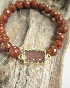 Glittering jasper quartz druzy is adorned with faceted gold sandstone beads along this stretch bracelet. Petite druzy stone is a beautiful rust color.