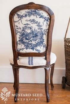 We love the use of two very distinct French fabrics a simple linen stripe and a busy Toile de  jouy