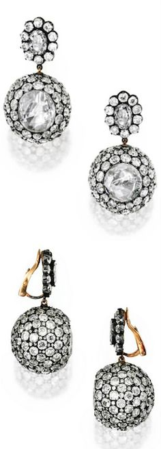 PAIR OF SILVER-TOPPED-GOLD AND DIAMOND BALL EARCLIPS, CIRCA 1860 The tops centered by two oval-shaped diamonds weighing approximately 2.40 carats, suspending spherical drops centered by two table-cut diamonds measuring approximately 13.5 by 13.6 mm and 14.6 by 13.5 mm, accented throughout with numerous old mine and old European-cut diamonds weighing approximately 38.00 carats, with French assay marks; earclip backs of modern design.