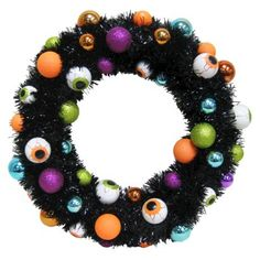 Eyeball Wreath--This could be a fun project, just buy a pre-made wreath form, some ping pong balls...paint 'um up to look like eye balls and get your glue gun ready!