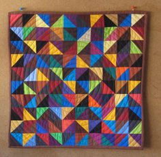 Triangle Patchwork Wall Quilt by PippaPatchwork on Etsy. $95.00, via Etsy.