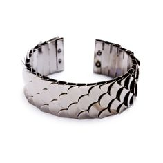 $28.00 The Michelle Cuff will mix and mingle well at the arm party. The unique design features scales of polished pewter that brilliantly catch the light.