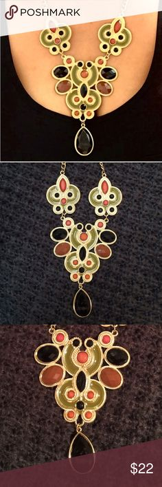 Gold Statement Necklace This necklace is in equal parts fun and fabulous. It is ornate and yet easily wearable. Jazz up any outfit with this statement piece. Colors: Brown, Black, Green. Clasp: Lobster clasp. Adjustable chain. Brand new. Never worn. All items from a smoke free home :) Reasonable offers welcome :) Jewelry Necklaces