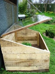 Mini greenhouse made from pallets and an old window frame