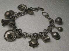 Vintage Silver Cowboy/Tex-Mex Charm Bracelet 7.5 by stampshopgirl