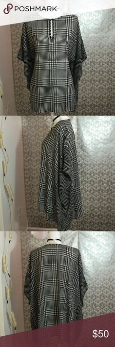 Michael Kors black / white cover up Lightly worn 27 inches in length black / white patterned cover up fabric is 100% polyester Michael Kors Tops