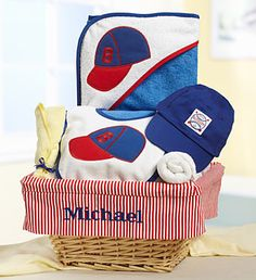 Personalized Baby Boy Little Slugger Gift Basket- wicker lined gift basket with embroidered baby's name, hooded terry cloth bath towel, and terry cloth bib with baseball cap embroidery, terry cloth washcloths rolled to look like a bat and ball and a super cute Infant Baseball Cap $89.99 #babyboy #newbaby #baseball