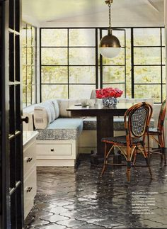 I love the dark tile on the floors in this kitchen. The whole room gives off a Parisian cafe vibe to me.