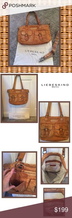 🌟Liebeskind Berlin Pocketbook🌟 Liebeskind Berlin bags are known for their fabulous leather! This unique front has a basket weave facade w two snapped front pockets set in a tan-caramel color. Back has an exterior zippered pocket. Great interior space w zippered pocket, one open pocket, and two smaller pockets. Comes w an unused strap to clip on for cross body. Couple of stains but he more ware on this bag.. the more gorgeous the leather looks!! Comes w dust bag. Liebeskind Bags Shoulder…