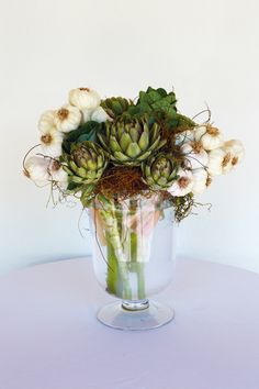 Garlic, artichokes and ornamental kale make for an artful arrangement - especially if the garlic is still brunched when you buy it.