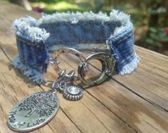 This is a frayed side seam denim bracelet with a large lobster clasp closure. There are two charms, a tree of life and a little bling charm. Bracelet Denim, Denim Earrings, Tassel Bracelet, Cuff Bracelets, Bling Centerpiece, Gland, Denim Crafts, Fabric Jewelry, Art Plastique