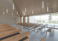 Stone funeral chapel with a pointy gable in Germany by Bayer & Strobel Architekten.