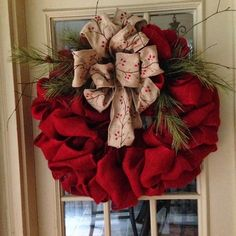 DIY burlap christmas wreath ideas red burlap large bow evergreen branches More