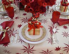 """My favorite color choice for a festive table is always red. No other color packs the punch that red does. I love single-color arrangements of roses, tulips, and carnations, so I did four of them for the centerpiece around an antique hurricane. The tablecloth is my very cheerful Celeste pattern. It says 'fun' instantly.""  — Michael Devine, Fabric designer and retailer, Kinderhook, NY   - HouseBeautiful.com"