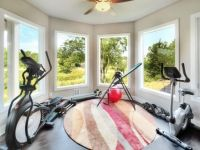 Exercise room with a wonderful view off the back of the house overlooking the golf course and fully equipped with a sauna and shares a jack and jill bath.
