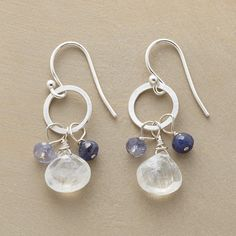 """PIROUETTE EARRINGS�--�Three gems pirouette on each sterling silver hoop: a moonstone briolette plus iolite and blue sapphire rondelles. French wires. Exclusive. Handmade in USA. 1-1/4""""L."""