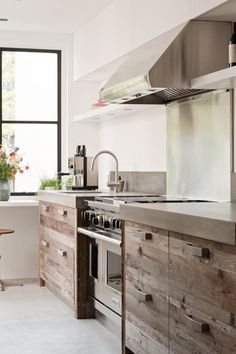 Concrete countertops, rough wood cabinets / drawers and stainless steel appliances complete this rustic modern kitchen design New Kitchen, Kitchen Interior, Kitchen Decor, Kitchen Ideas, Interior Doors, Natural Kitchen, Kitchen Styling, Cozy Kitchen, Scandinavian Kitchen