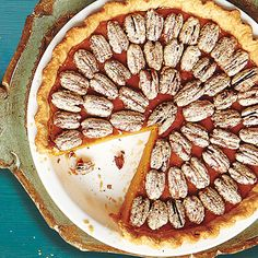 Sweet Potato Pie with Sugared Pecans; we won't say that the sugared pecans are the best part of this holiday pie recipe, but they sure don't hurt! Better make a double batch.