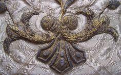 Metallic trim on silver fabric