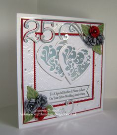 """I had a couple of Silver Annivesary cards to make so the first one I used the """"Hearts in Squares"""" design again in Silver and Red - Using Dies from Spellbinders - Grand Squares, Vines of Passion, Bitty Blossoms , Tonic Studios - Scalloped Squares, Memory Box - Numbers, DieNamics - FishTail Banners and Crafts Too - Flourish. Embossing folders used is Crafters Companion - A4 Rose Swirls and Spellbinders Dainty Dots."""