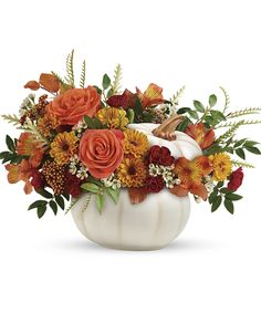 Enchanted Harvest   Bursting from an enchanting white ceramic pumpkin, this fabulous fall mix of roses and mums is a magical addition to your autumnal gatherings! #ellentonflorist Pumpkin Bouquet, Pumpkin Flower, Fast Flowers, Buy Flowers, Mini Carnations, Peach And Lily, Unique Centerpieces, Willow Branches, Fall Arrangements
